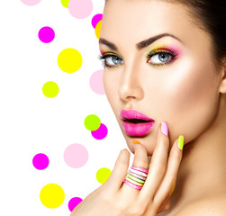 Foto op Canvas Beauty Beauty girl with colorful makeup, nail polish and accessories