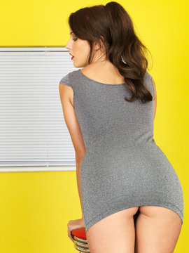 Sexy Young Woman Leaning Over a Stool
