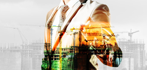 double exposure of businessman and construction site, business c