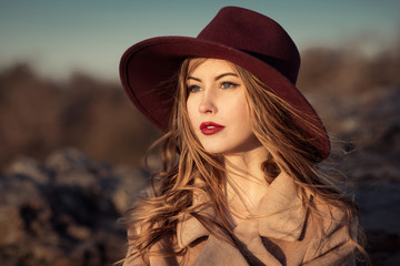 Portrait of elegant woman with red lips in hat