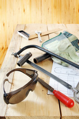 Composition with several locksmith working tools on the woods