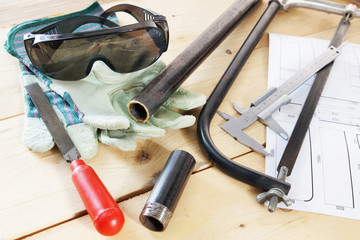 Composition with several locksmith working tools on a workbench