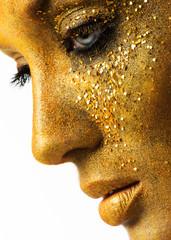 beautiful woman model with professional makeup, golden face