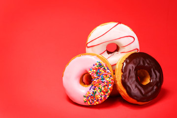 Sweet donuts on red background