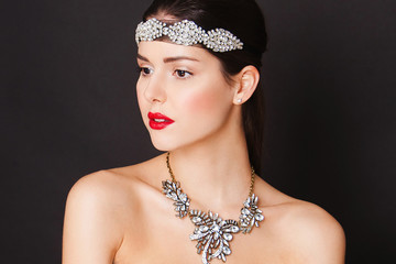 Beautiful woman with evening make-up, luxury necklase and big