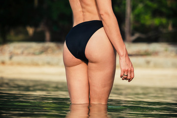 The rear of a sexy woman on tropical beach