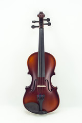 Wooden violin on white background