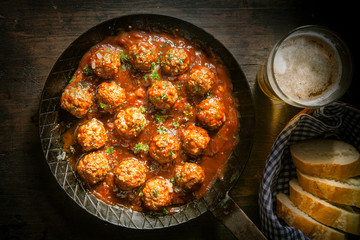 Rustic wholesome lunch of meatballs and beer