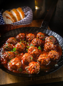 Succulent fried meatballs in a spicy sauce