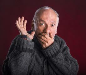 Surprised elderly men