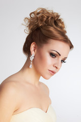 Portrait of a beautiful bride with makeup and hairstyle