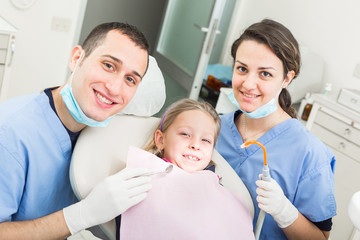 Dentist and Dental Assistant Portrait with Young Patient.