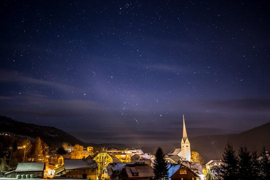 clean night starry sky over highland Austrian town