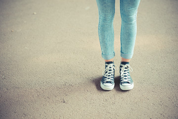 close up of legs woman with leggings and sneakers