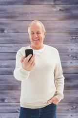 Composite image of happy mature man sending a text