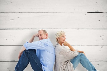 Composite image of upset mature couple not talking