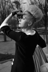 Elegant blond woman in retro style in the autumn street