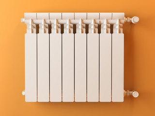 Heater radiator on yellow wall in house