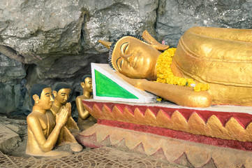 Reclining Buddha statue in the Elephant Cave in Vang Vieng