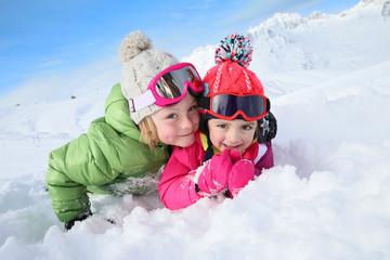 Portrait of kids enjoying winter vacation at ski resort