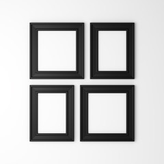 four blank black photo frames on white wall
