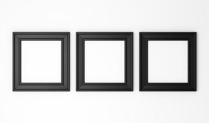 three blank black photo frames on white wall