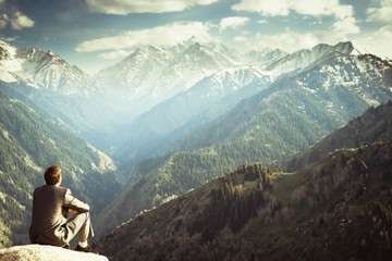 businessman at the top of the mountain sitting and thinking Wall mural