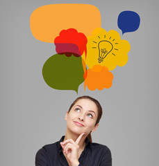 Business woman looking up on idea bulb in color bright bubble