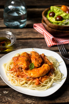 Chicken breasts in tomato and cream sauce with pasta