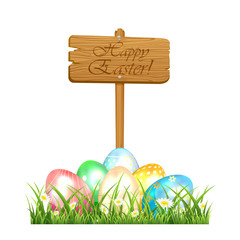 Easter eggs and wooden sign