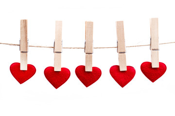 Red fabric heart hanging on the clothesline