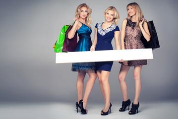 Smiling girls shopping.