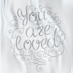 Hand drawn text lettering. You are loved
