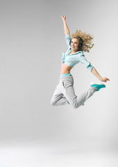 Blond athlete dancing and jumping