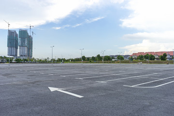 Empty parking lot with construction background