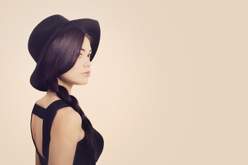 Young and beautiful woman in hat over white background
