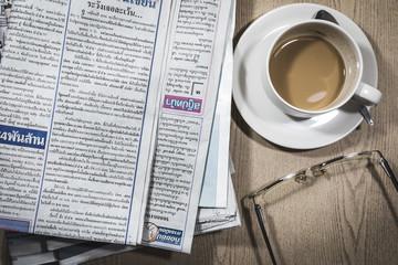 Newspaper, coffee and eyeglasses