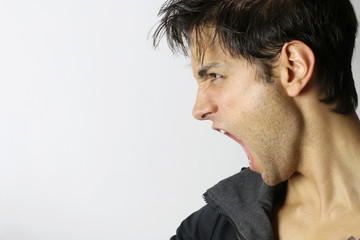 portrait of a man screaming in rage