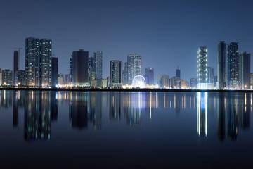 Sharjah City skyline at night. Sharjah, United Arab Emirates