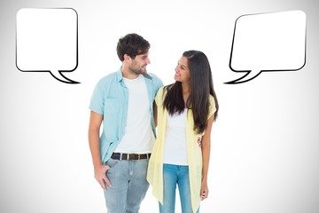 Composite image of happy casual couple smiling at each other