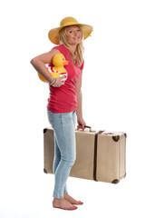 Frau mit Badeente und Reisekoffer