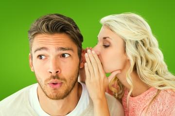 Attractive blonde whispering secret to boyfriend
