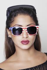 Woman wearing american sunglasses