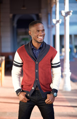 Charming african american man smiling outdoors