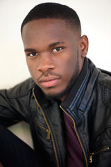 Handsome african american man posing in black leather jacket