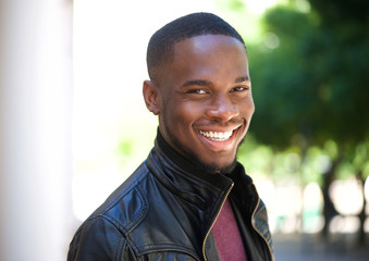 Cheerful young african american man smiling outside