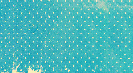 Old yellowed polka dots paper close up, background