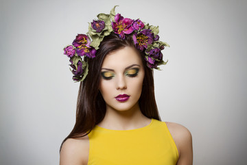 beautiful woman with bright makeup floral crown