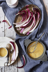 radicchio treviso quality on tray and cornmeal flour for polenta