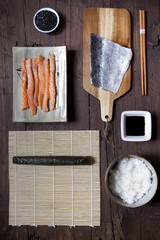 overhead shot of ingredients for preparing sushi on table